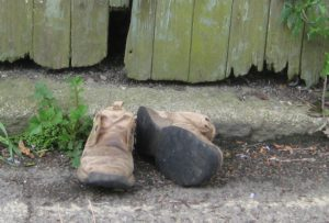 boots by a gate